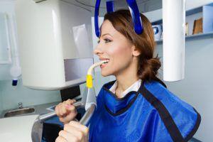 Woman having a dental xray taken