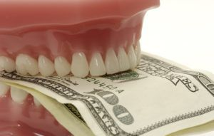 Dentures with money in between
