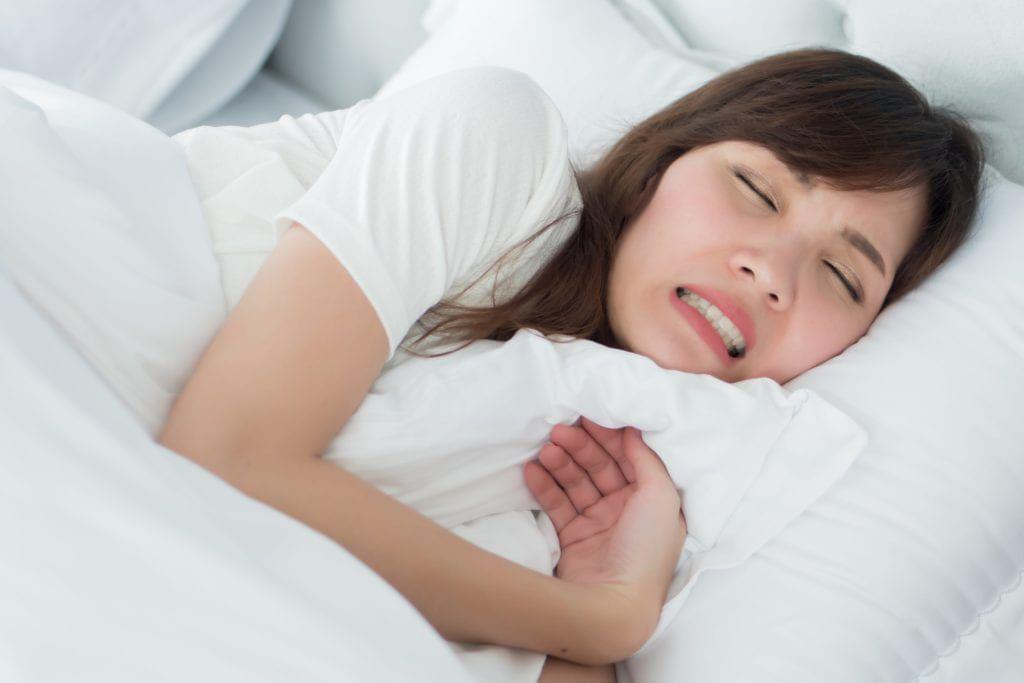 woman grinding her teeth in her sleep