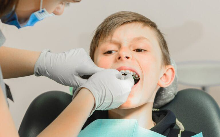 Child receiving Orthodontic Care For Protruding Teeth